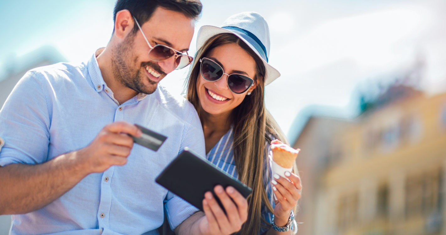 Couple using credit card