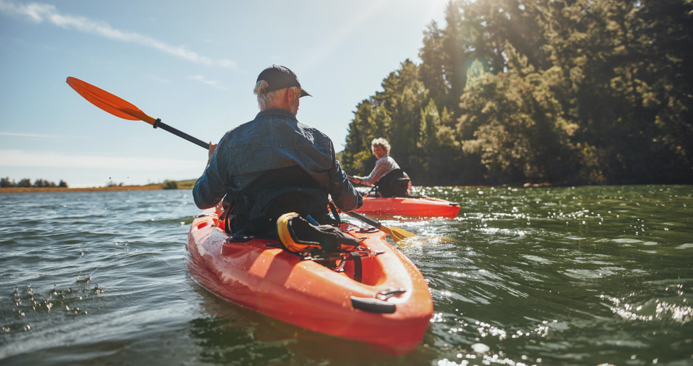 Older and younger man in kayaks